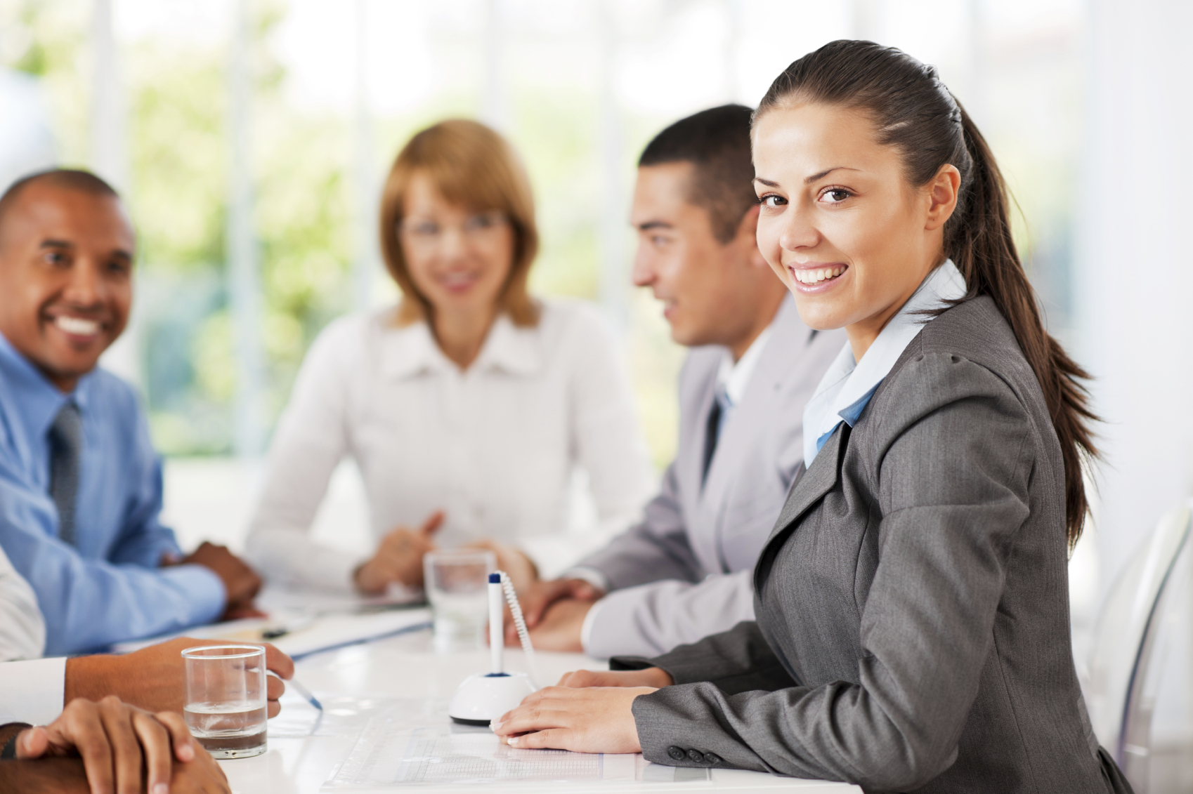 Successful group of businesspeople working in office. They are on a meeting.  The focus is on the beautiful brunette looking at the camera.   [url=http://www.istockphoto.com/search/lightbox/9786622][img]http://img543.imageshack.us/img543/9562/business.jpg[/img][/url]  [url=http://www.istockphoto.com/search/lightbox/9786738][img]http://img830.imageshack.us/img830/1561/groupsk.jpg[/img][/url]